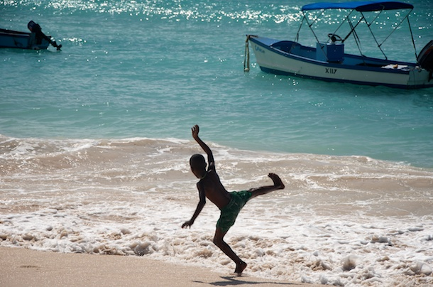 Playing in the Surf, Oistins Fish Market By Day, Barbados by Kathleen Bennett