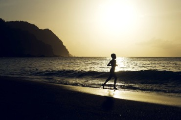 Running Along Castara Beach by Patrick Bennett