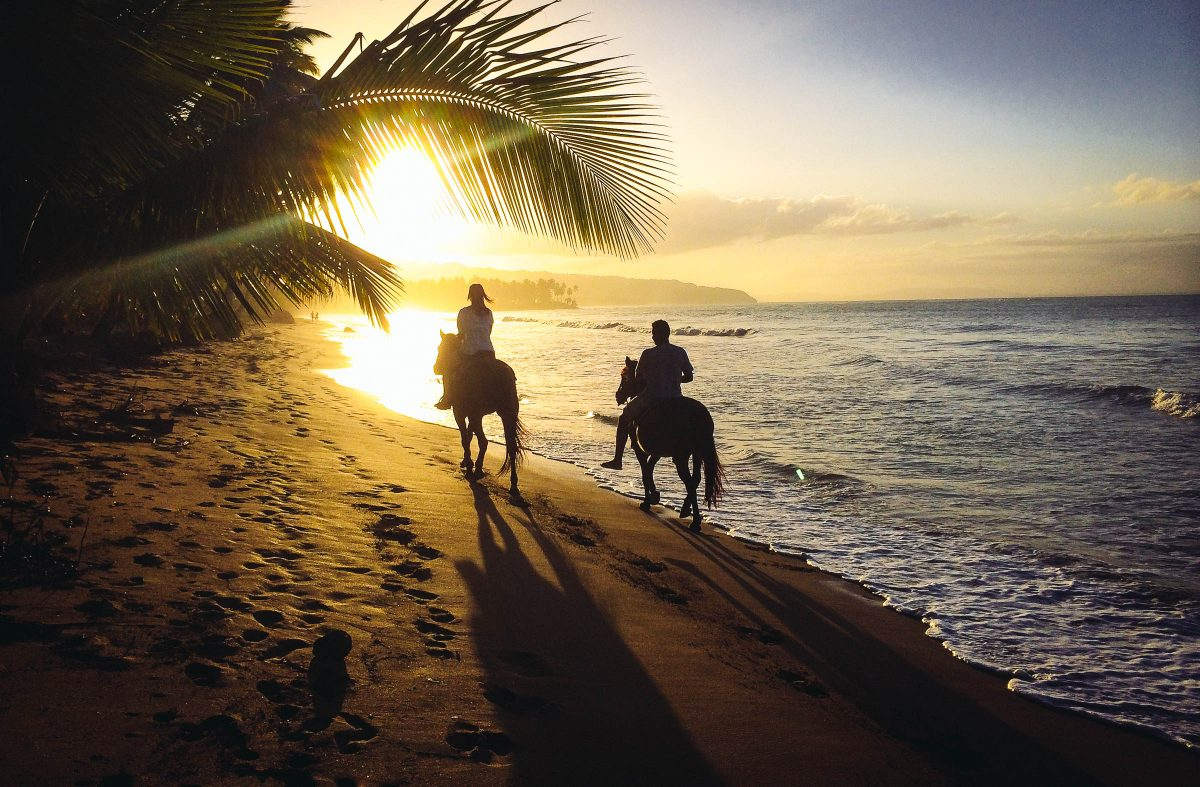 Horseback riding at sunset on the beach near Las Terrenas by Patrick Bennett