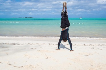 Lucien of PappaSurf handstand on Cable Beach, Nassau by Patrick Bennett