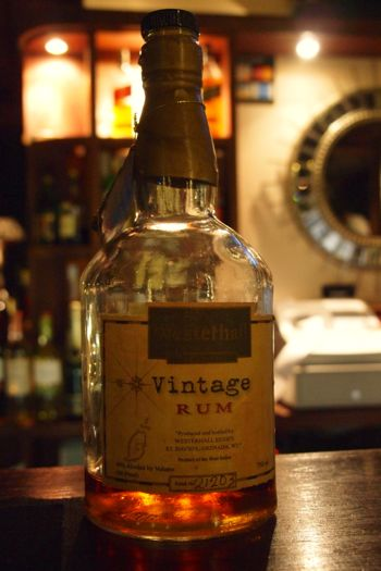 My Smiling Bottle of Vintage Rum at Le Phare Bleu, Grenada | SBPR