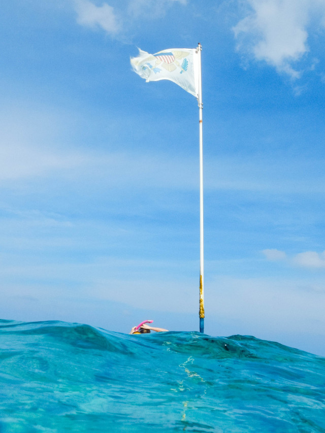 USVI flag above the waves by Patrick Bennett