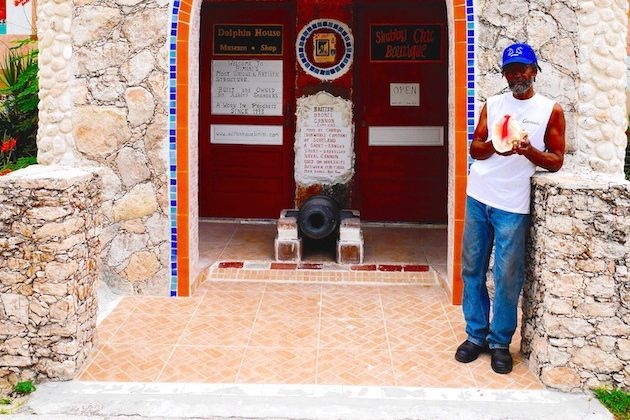 Bahamian artist Ashley Saunders outside his masterwork, Dolphin House in North Bimini   Credit: Zickie Allgrove