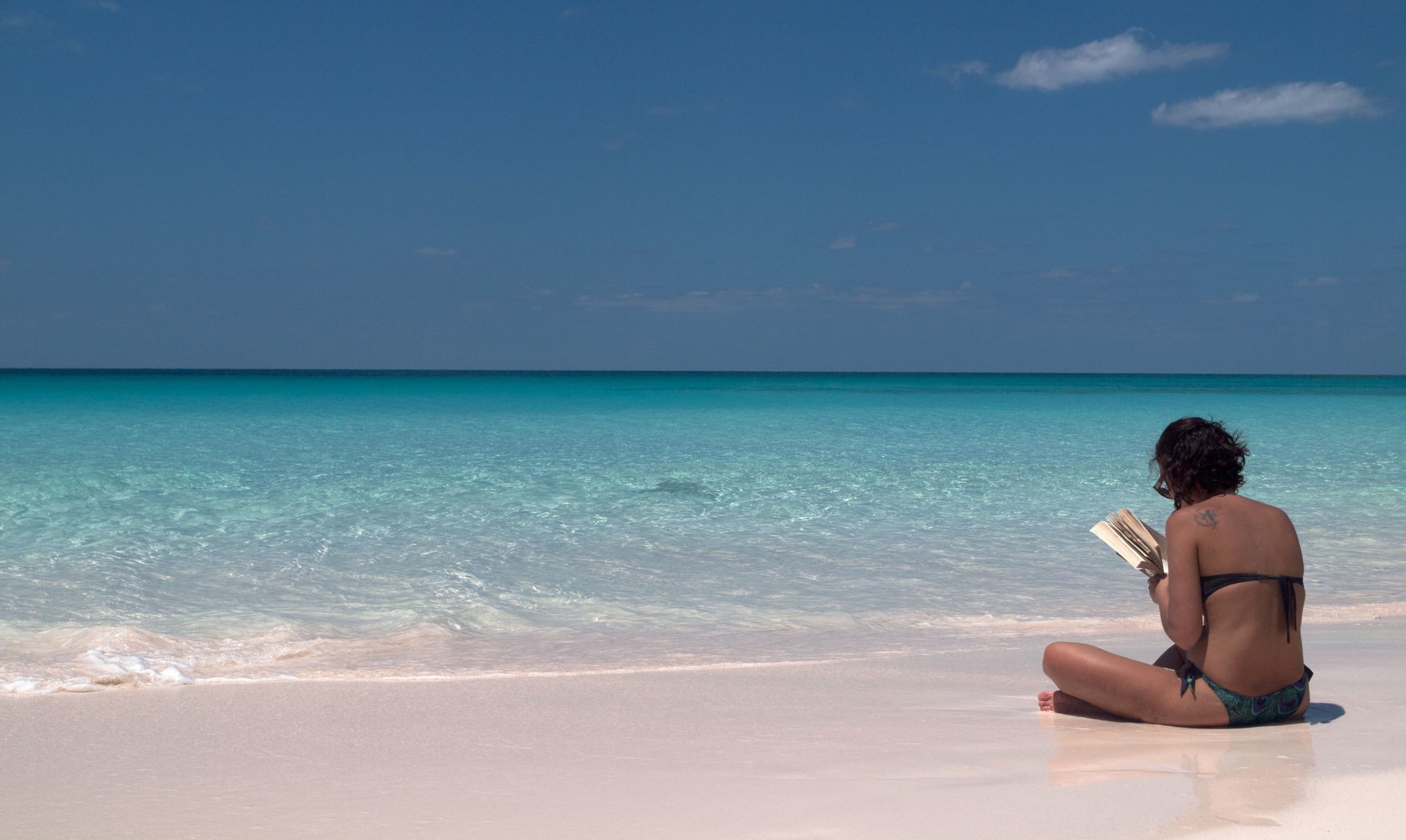 Seaside Reading On Lighthouse Beach Eleuthera Bahamas