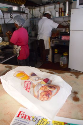 Enoch's wife making Johnny Cakes as he seasons some fish | SBPR
