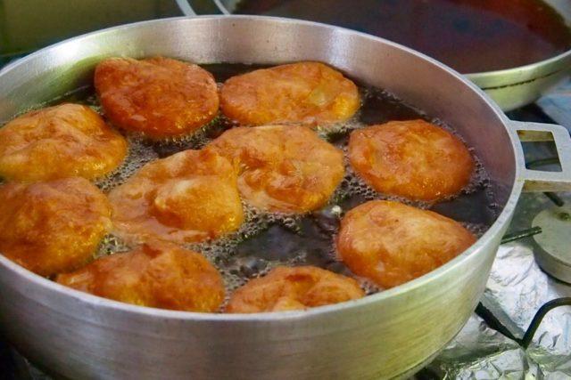 Johnny Cakes frying up at Vena's on Mero Beach, Dominica | SBPR