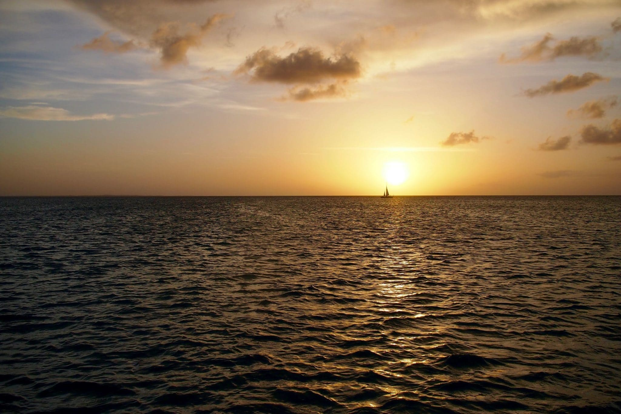 One Sailboat at Sunset in the Turks and Caicos