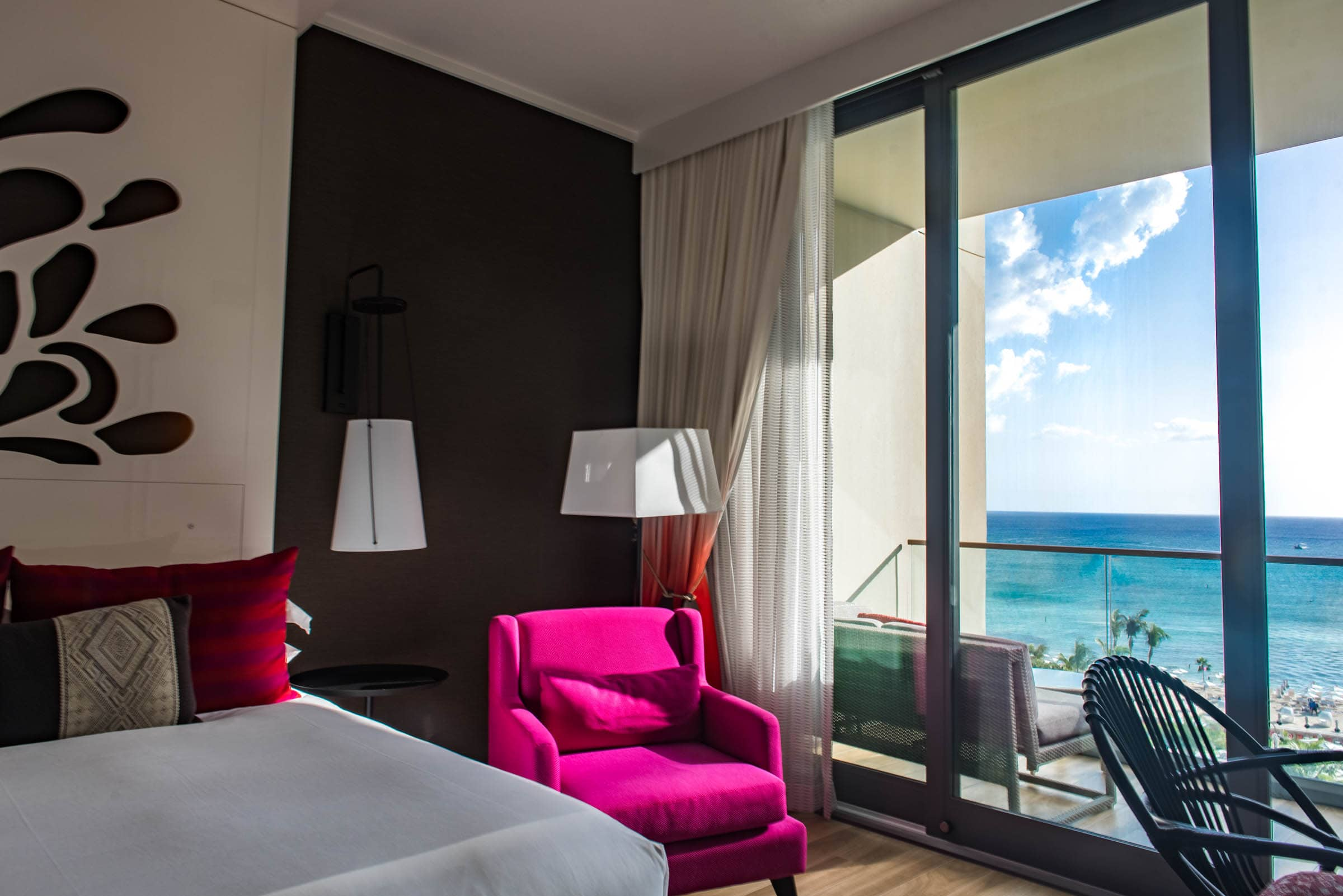 The rooms are modern, brightly accented, and feature huge windows.