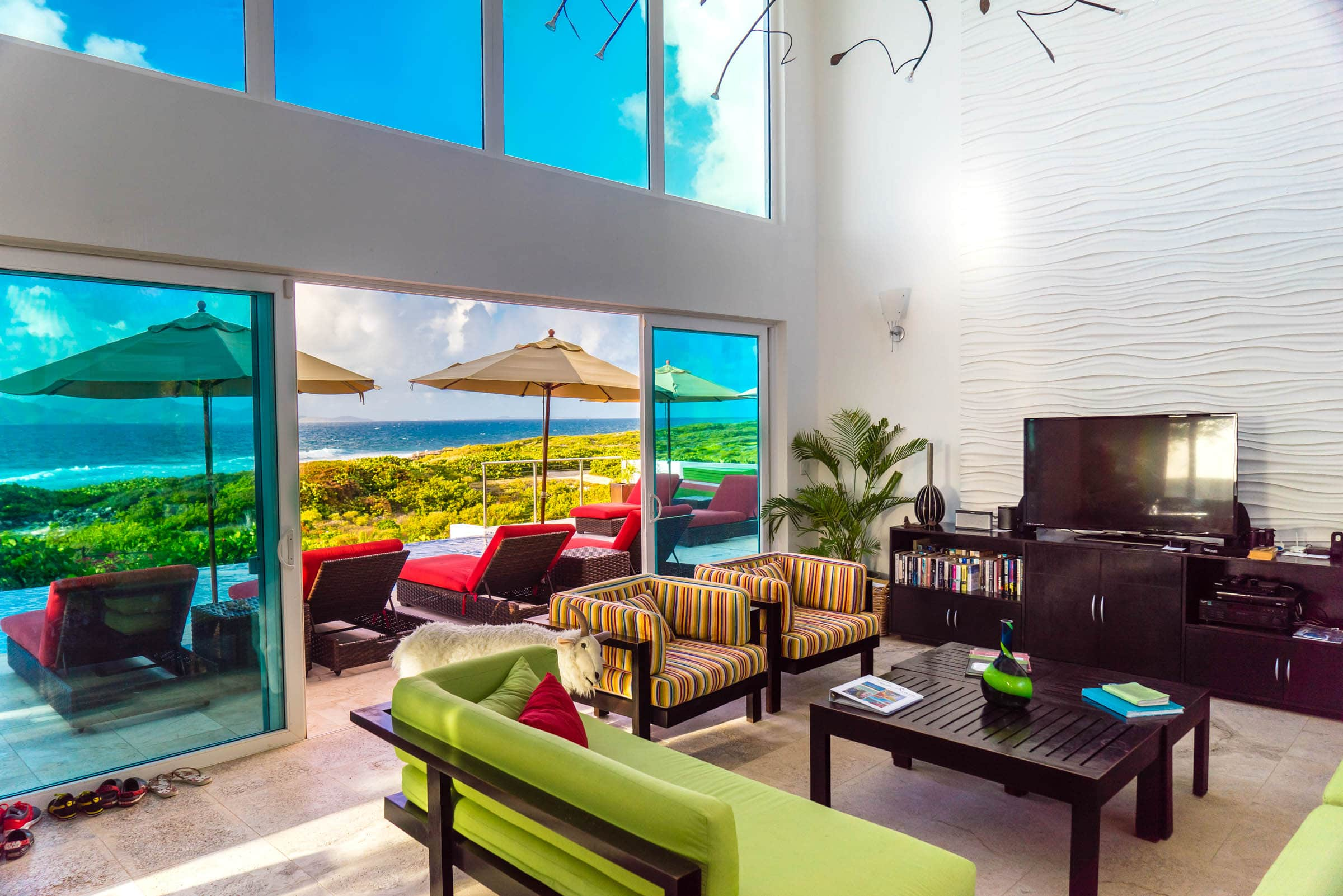 The main living area is a spacious two-story area made more perfect when the doors are opened to welcome the sea breeze.