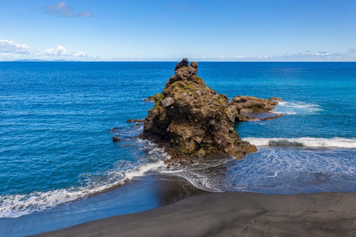 Volcanic rock formations dot the landscape