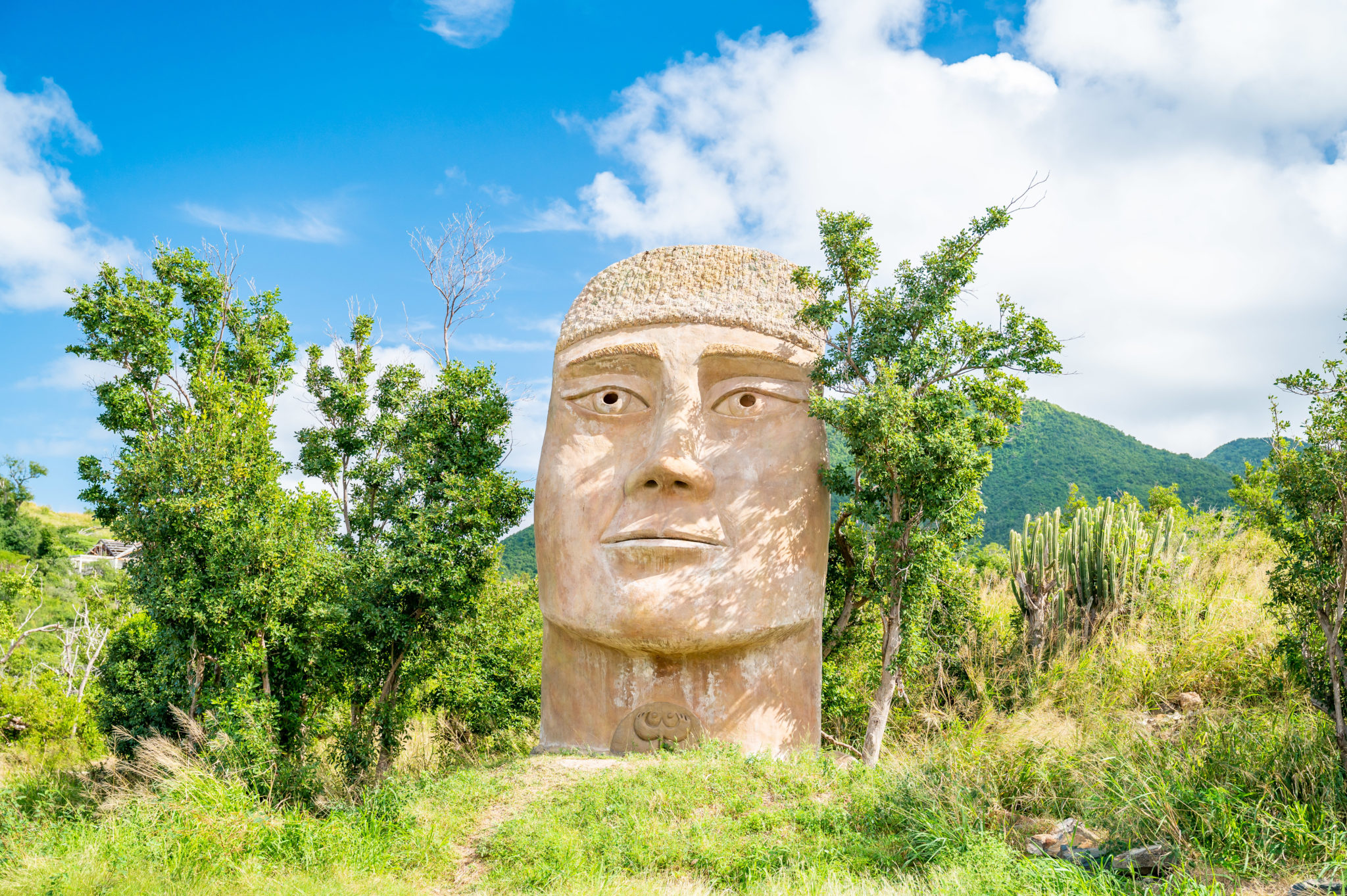 Happy Bay St. Martin Sculpture: Ancient Wonder or EDM Idol